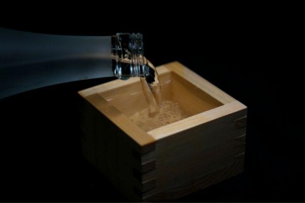 pouring bubbly sake