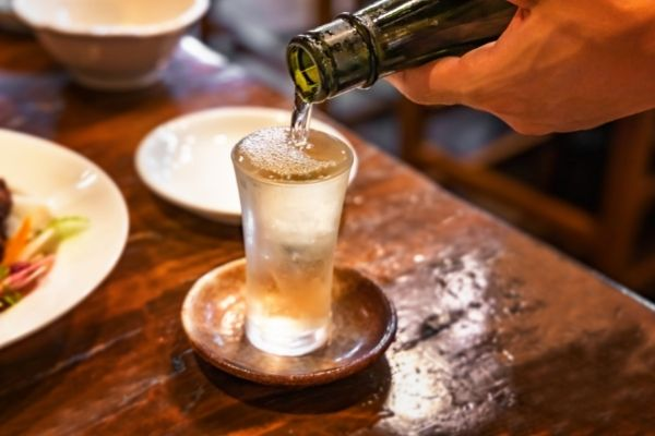 pouring sake from bottle